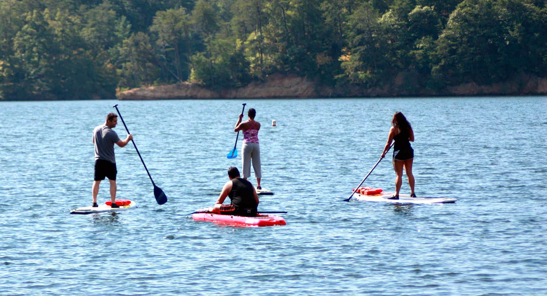 A group enjoys paddle boarding in Ocoee, TN