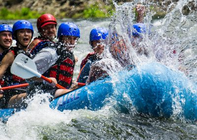 Group Trip - Whitewater rafting on the Ocoee River - blue raft with big splash
