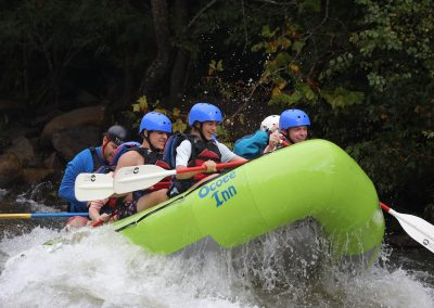 Ocoee River group whitewater rafting in green boat